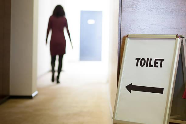 woman going to toilet